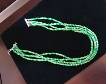 Four Strand Green Bead necklace with silver accent