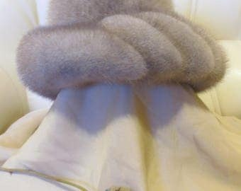 The hat is made of natural mink fur. color gray, excellent condition.