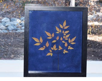 Golden Yellow real pressed plant with indigo background  in a dark brown/black wood Frame