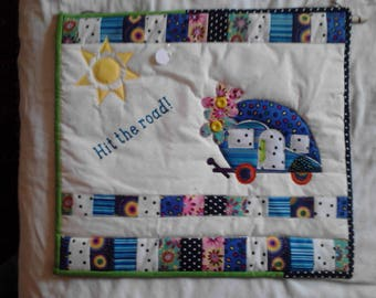 Hit the Road camper wall hanging. Quilted with applique. Complete with hanging sleeve and wooden dowel.