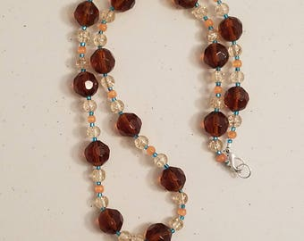Seashell necklace with Brown, orange, and clear glass beads