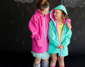 Children raincoats. Toddler and Kids Girls' Jacket. Wind-resistant. Multicolor.