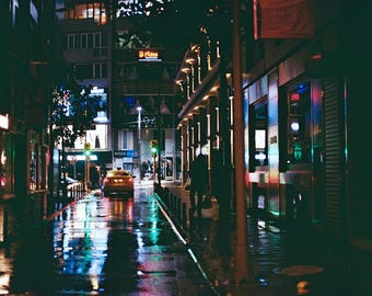 colourful street lights at night on a rainy day
