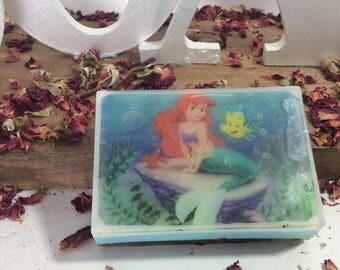 Handmade organic soap with mermaid cartoon design on it