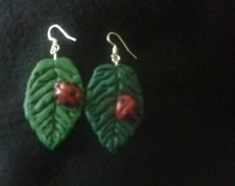 Ladybird on leaf earrings.
