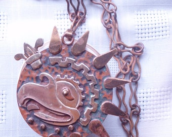 Vintage Hammered copper and brass bird pendant from Mexico