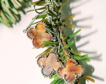 The beautiful Earrings With beautiful natural stones. Van Cleef  inspiration on my work
