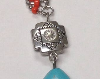 Turquoise blue stone aztec/native american style necklace