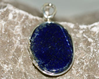 Substantial Lapis Lazuli Pendant. Elegant, symmetric stone fitted in sterling silver setting. Handmade & unique.