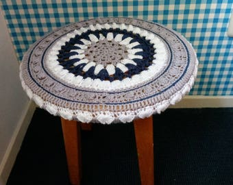 Old school stool with crocheted seat.
