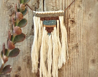 Knotted necklace on cotton