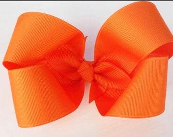 4 inch orange boutique bow