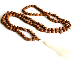 Brown beaded necklace with white tassel