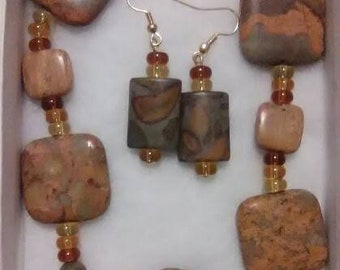 This is a natural Jasper and bamboo Jasper set which contains a necklace and earrings.