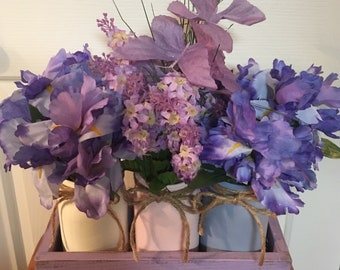 Purple planters box with jars and flowers