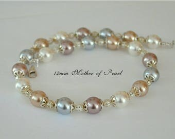 "Mother of pearl 17 1/2"" necklace, very high luster round 12mm pearls, white, chocolate, silver, and gold, .925 sterling silver lobster clasp"