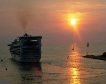 Cruise ship leaving Puenta Vallerta at sunset
