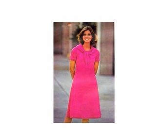 SALE 1970s Misses High Fitted Flared Dress Butterick 4610 Vintage Sewing Pattern Scoop Neck Raglan Sleeve Dress Size 14 Bust 36 UNCUT