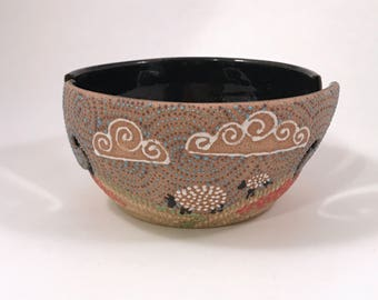 """Double slotted Yarn Bowl with Meadow scene in """"beaded"""" glaze."""