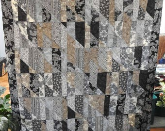 Stunning contemporary quilt in metallic fabrics