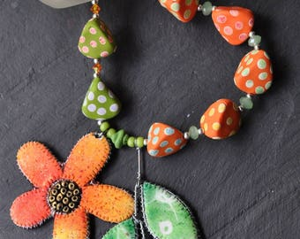 necklace - orange flower and green leaves