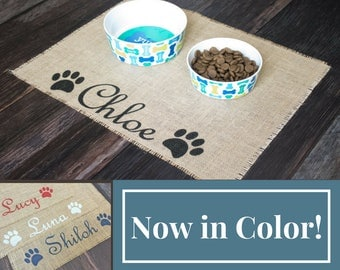 Custom colored puppy dog pet placemat for dog food bowls - personalized with your pets name between the paws! Now with a rainbow of colors
