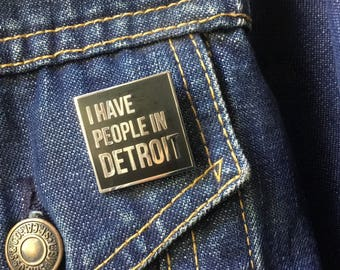 I have people in Detroit. enamal pin