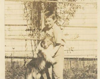 Vintage photo snapshot Boy Holds Miniature Collie Puppy Dog