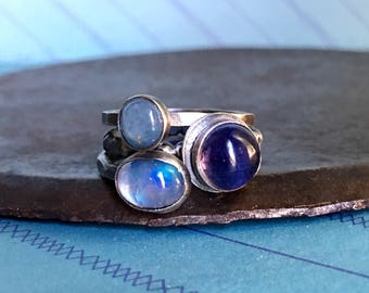 calm, courage, and balance. tanzanite, aquamarine, and moonstone stack
