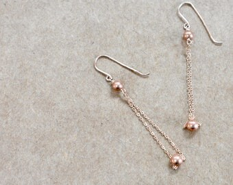 rose gold chain earrings with copper balls. dangle earrings. minimalist chain earrings. rose gold and copper jewelry. ball and chain