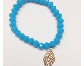 Ocean Blue 5mm Faceted Crystal Bead Bracelet with Gold Peacock Feather Charm