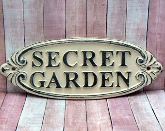 Secret Garden Gate Wall Plaque Sign Cast Iron Distressed Shabby Elegance Off White Oval Oblong Ornate Scroll Accented Wall Door Sign