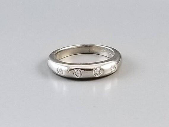 Stunning highly polished modern estate European platinum and four diamond wedding band ring, 7.2 grams, size 5