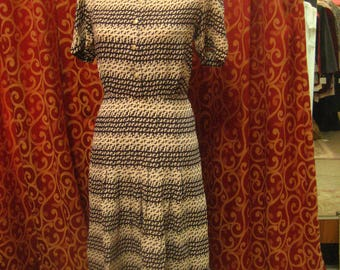 """1940's, 38"""" bust, geometric print dress of white and navy blue rayon."""