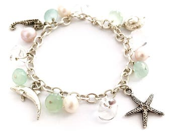 Luxe Beach Bracelet. Dolphin, Starfish, Chalcedony, Nautilus, Pearl, Crystal Sterling Silver Bracelet. Beach themed wedding bracelet.