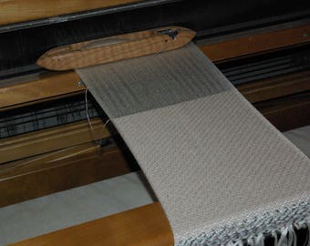 Scarf handwoven on loom on arm