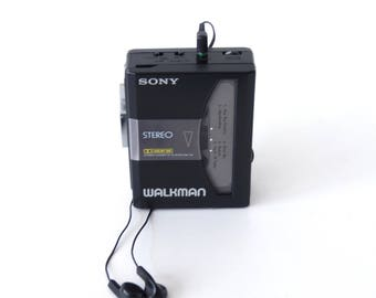Stylish little Sony Walkman WM-34 portable stereo cassette player with headphones.