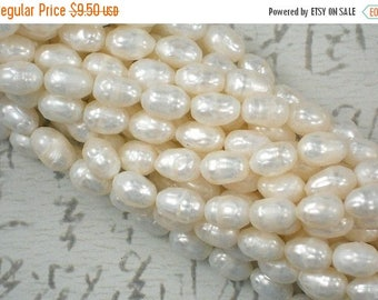 ON SALE 20 Faceted Oval Pearls Freshwater Creamy White - 1/2 strand (4049)