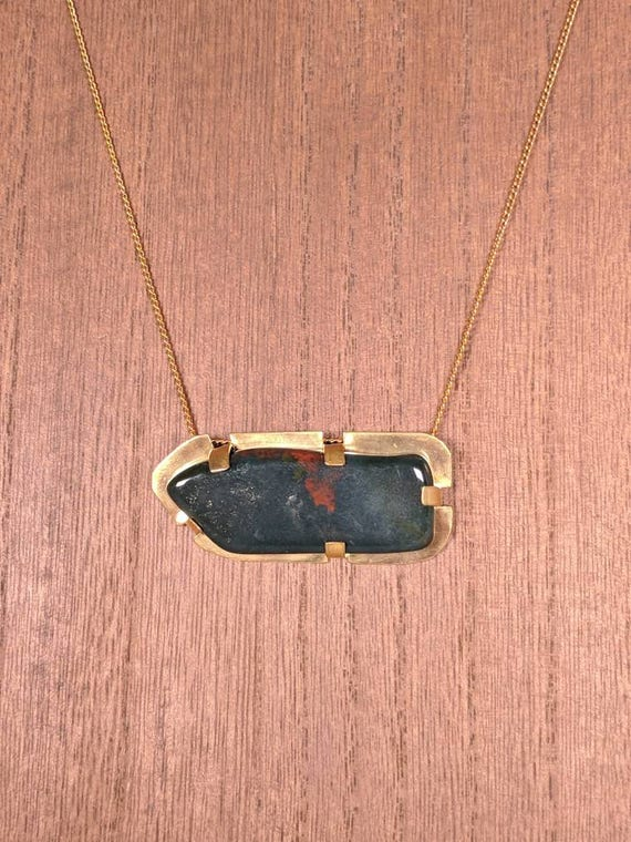 bloodstone and brass pendant