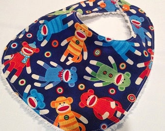 On Sale Sock Monkey - Infant or Toddler Bib - Terry Cloth Backing - Reversible with ADJUSTABLE Snaps