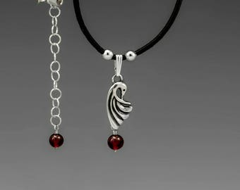 Crane Sterling Silver Pendant with Garnet on Black Leather Cord