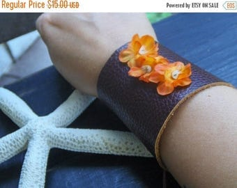 SALE The Hibiscus Gypsy Wrist Cuff  Leather Bracelet . Victorian corsette style Leather laced cuff. Orange silk flowers embellished