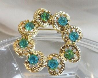 SALE Vintage Blue Green Circle Brooch. Gold Tone. Blue Green Aqua Rhinestones.