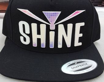 Shine Flat Brim Hat in Black with Super Reflective Writing and Snap Back Fit