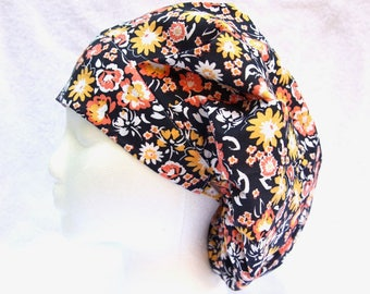 Bouffant Surgical Scrub Cap, Scrub Hat for Woman, Ties into a Ponytail Scrub Hat. Orange, yellow and white on navy