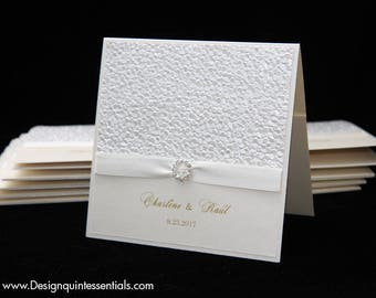 Ivory Pebble Embossed Wedding Invitation with Ivory Ribbon in Champagne Square Folded Pocket