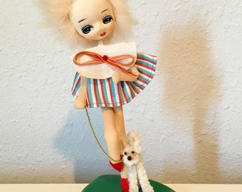 Japanese stocking big eye doll with leashed dog