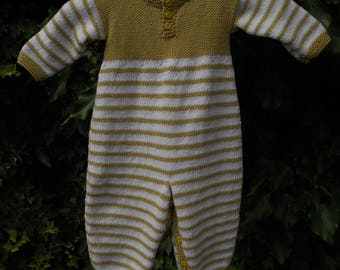 Romper/onesie/all in one/playsuit for a baby boy or girl. Hand knitted in soya cotton/acrylic yarn.Chest 20 in, age 6-12 months