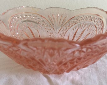 A small, Art Deco pressed glass trinket bowl in pink.