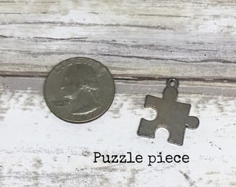 Puzzle charm necklace
